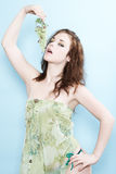 Patty with grapes2. Model with make-up, in  a green dress Royalty Free Stock Photo