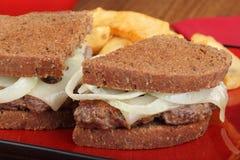 Patty Melt Closeup. Closeup of a patty melt sandwich with cheese and onions Stock Photo