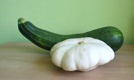 Pattypan squash and courgette. On a desk Stock Photos