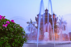 Patuxai arch or Victory Triumph Gate monument with fountain in front. Vientiane, Laos Stock Images