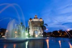 Patuxai monument Gate of Triumph, Vientiane, Laos. Fountains near Patuxai monument, Vientiane, Laos royalty free stock photo