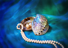 Paua shell and pearl ornaments Royalty Free Stock Images