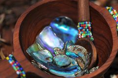 Paua shell pieces in handcrafted beaded wooden bowl Royalty Free Stock Images