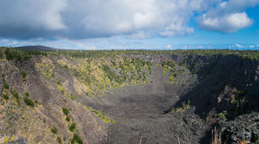 Pauahi Crater in Hawaii Volcanoes National Park. An enormous lava-crater & x28;Pauahi& x29; in Volcanoes National Park - Big Island of Hawaii. And a tiny rainbow Royalty Free Stock Photos