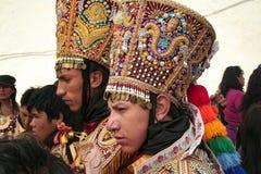 Man wearing a typical hat at Paucartambo`s Festival of Virgen del Carmen. Paucartambo, Cusco, Peru - Circa July 2013: Man wearing a typical hat at Paucartambo`s royalty free stock photos