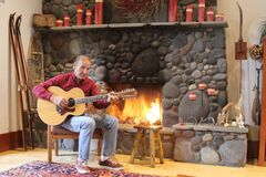 Paul - Fireplace and Guitar 2.JPG Stock Photos