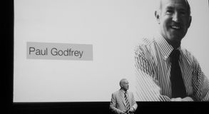 Paul Godfrey in front of his own image. During Boldtakls 2014 Dubai edition, Farah Nasrawi painting live on stage inspired by some of the talks during the Stock Image