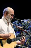 Paul Stookey Playing Guitar. ST. PETERSBURG, FLORIDA - FEBRUARY 18, 2012: Paul Stookey, best known as Paul in the folk trio Peter, Paul and Mary, performs at The Royalty Free Stock Photography