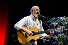 Paul Stookey Songwriter. ST. PETERSBURG, FLORIDA - FEBRUARY 18, 2012: Paul Stookey, best known as Paul in the folk trio Peter, Paul and Mary, sings at The Royalty Free Stock Photos
