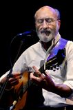 Paul Stookey on Stage. ST. PETERSBURG, FLORIDA - FEBRUARY 18, 2012: Paul Stookey, best known as Paul in the folk trio Peter, Paul and Mary, plays his guitar at Royalty Free Stock Photo