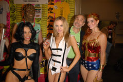 Paula LaBaredas,Phoebe Price,Alicia Arden. Alicia Arden as Aeon Flux, Paula Labaredas as Barbarella, Lloyd Kaufman and Phoebe Price as Wonder Woman Royalty Free Stock Photo