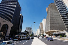 Paulista Avenue Sao Paulo Brazil. The buildings and the two lane busy traffic street of Paulista Avenue in downtown Sao Paulo, Brazil Royalty Free Stock Photo