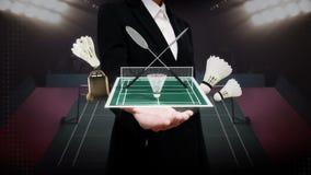 Paume ouverte de femme d'affaires, icône de badminton, volant, filet, stade de badminton clips vidéos