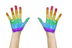 Paumes des mains humaines peintes dans des couleurs d'arc-en-ciel Images stock