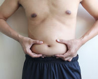 Paunch fat person. Man hands on belly Stock Photos