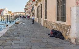 Pauper on a Grand Canal in Venice Italy Stock Photography