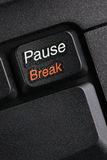 Pause Break. A macro image of the Pause/Break computer key of a laptop computer. Suitable for work timeout concepts, rest during office work, etc stock photo