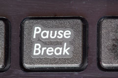 Pause, break closeup on a keypad. Time to rest. Royalty Free Stock Images