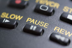 Pause button. A close up of the pause button on a remote control stock image
