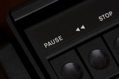 Pause button from a very old cassette player. Pause button on a very old cassette player. Rewind button next to it stock images