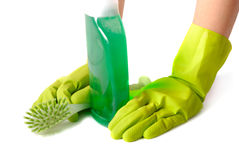 Pause Of Housekeeper. Gloved hands with brush and green fluid cleanse over white background Royalty Free Stock Photography