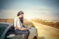 Pause during the journey. Young woman doing a pause during her journey Royalty Free Stock Photography