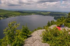 A pause at the top in Eastern Townships, Canada. Cherry on the sundae with this view on Lyster Lake from Pinacle Mountain trail, province of Quebec, Canada stock photos