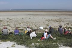 Pause during a tour of monuments  on the Wadden island Griend. Netherlands Stock Photo