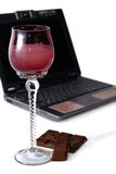 Pause Of Web Surfer. Glass with beverage, dark chocolate and notebook over white background Stock Images