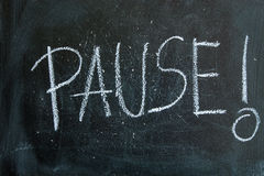 Pause written in chalk on a blackboard Stock Photo