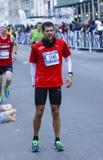 Pausing with leg cramp Stock Photo