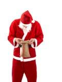 Pauvre Santa Claus avec le sac vide dans le studio Image stock