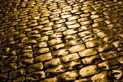 Pavé avec de l'or ! Photo stock