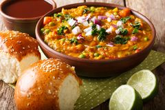 Pav bhaji - popular Indian street food close-up in a bowl. Horizontal. Pav bhaji - popular Indian street food close-up in a bowl on the table. Horizontal stock images