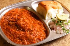Indian Food - Street Food - Pav Bhaji. Pav Bhaji, a very popular Indian street food, especially popular in Mumbai. Mixed Vegetable Mashed into a Gravy, consumed Royalty Free Stock Photography