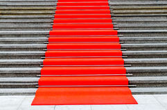 Pave in red carpet stairs. Entrance Stock Photography
