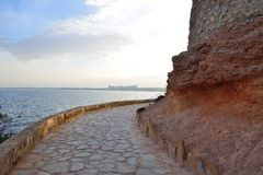 Paved coastal walkway on a summer evening Royalty Free Stock Photography