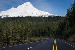 Paved highway beneath snowy Mount Hood, Oregon Royalty Free Stock Image
