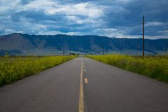A old rustic road leading to Sheep mountain from Lake Hattie, Laramie, Wyoming. A paved 2 lane road leading to Sheep mountain from Lake Hattie, Laramie, Wyoming stock image