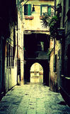 Paved old narrow passage in Venice Stock Photography