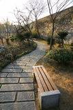 Paved path with bench Stock Photos