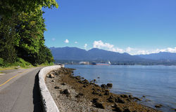 Paved path at Stanley Park Stock Photos