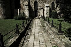 Paved path to the church Stock Image