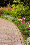 Paved path or walk through garden Stock Photo