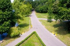 Paved pathways in park. A view of the intersections of several paved pathways or walkways in a public park Royalty Free Stock Images