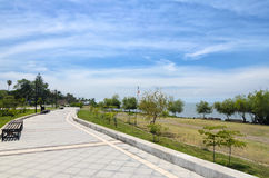 Paved pedestrian road along Chapala lake on a sunny day Stock Image
