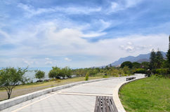 Paved pedestrian road along Chapala lake on a sunny day Royalty Free Stock Photos