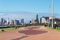 Paved Promenade Against City Skyline in Durban South Africa. Quiet early morning paved promenade against city skyline and blue cloudy sky in Durban, South Africa Stock Image