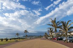 Paved Promenade Against Coastal Landscape and Blue Cloudy Sky stock photography