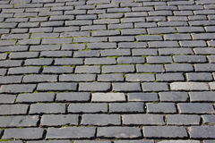 Paved road. Brick, cobble street stock images